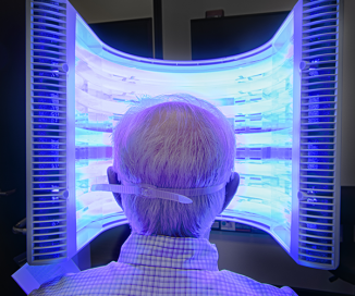 Photo of patient getting Blue Light treatment